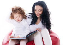 The child hold a book with mother  Royalty Free Stock Photos