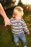 Child hold hand Stock Image