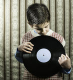 Child hold lp Stock Photos