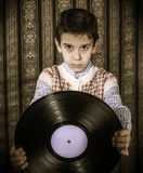Child hold lp Royalty Free Stock Photos