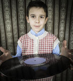 Child hold lp Stock Photography