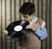 Child hold lp Royalty Free Stock Image