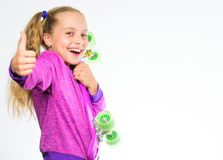 Child hold penny board. Penny board of her dream. Best gift for kid. Kid long hair carry penny board. Plastic. Skateboards for everyday skater. Choose stock images