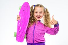 Child hold penny board. Penny board of her dream. Best gifts for kids. Ultimate gift list help pick perfect present for. Girl. Kid long hair carry penny board royalty free stock images