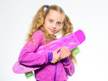 Child hold penny board. Penny board of her dream. Choose skateboard that looks great and also rides great. Best gift for. Kid. Kid long hair carry penny board royalty free stock photography