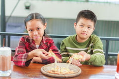 Child hold pizza Royalty Free Stock Image