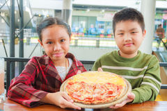 Child hold pizza Royalty Free Stock Photo