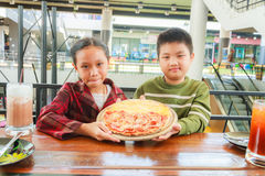 Child hold pizza Royalty Free Stock Images