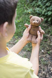 Child hold teddy in the hands Royalty Free Stock Photo