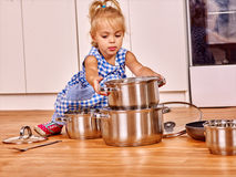 Child holdig pan at kitchen Stock Image