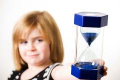 Child holdin hourglass Stock Photo