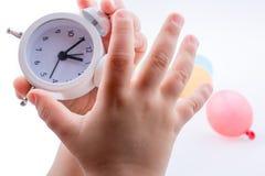 Child holding an alarm clock Stock Photography