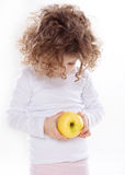The child holding apple isolated Stock Images