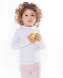 The child holding apple isolated Stock Photography
