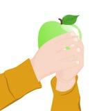Child holding an apple Stock Photos