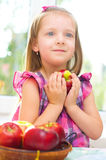 Child holding apples Stock Images