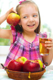 Child holding apples Royalty Free Stock Image