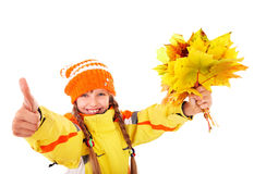 Child in holding autumn leaves thumb up. Girl in autumn orange hat holding leaves thumb up.  Isolated Royalty Free Stock Photo