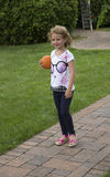 Child holding a ball Stock Image