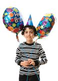 Child Holding Balloons during his birthday party. White background. Royalty Free Stock Image