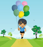 Child holding balloons Royalty Free Stock Photos