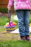 Girl holding a basket with easter eggs royalty free stock photo