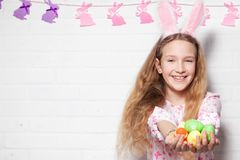 Child is holding a basket with Easter eggs Royalty Free Stock Photo