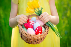 Child holding basket with Easter eggs Royalty Free Stock Images