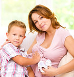 Child holding belly of pregnant woman Royalty Free Stock Images