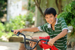 Child Holding Bicycle Stock Photography