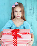 Child holding big gift Stock Image