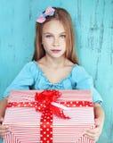 Child holding big gift Stock Image