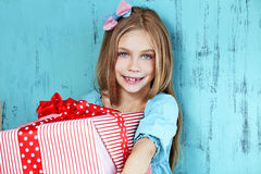 Child holding big gift Stock Photography