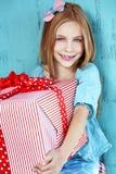 Child holding big gift Royalty Free Stock Image