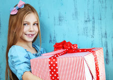 Child holding big gift Stock Photos