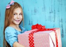 Child holding big gift Stock Photos