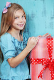 Child holding big gift Royalty Free Stock Images