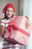 Child holding big gift Royalty Free Stock Photography