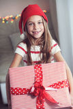 Child holding big gift Royalty Free Stock Photos