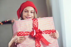 Child holding big gift Royalty Free Stock Image