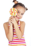 Child holding big lollipop stock photography