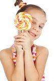 Child holding big lollipop royalty free stock photo