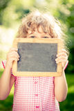 Child holding blackboard blank Royalty Free Stock Photography