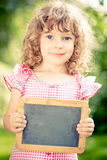 Child holding blackboard blank Stock Photo