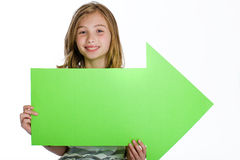 Child holding blank arrow sign Royalty Free Stock Photography
