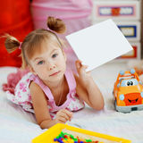 Child holding blank card Stock Photography