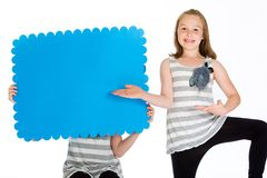 Child holding a blank green arrow sign. Stock Photography