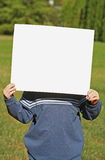 Child Holding a Blank Sign Stock Photography