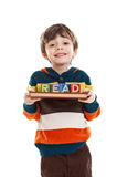 Child holding book and blocks for reading Royalty Free Stock Photo