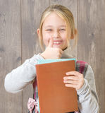 Child holding a book Stock Photo